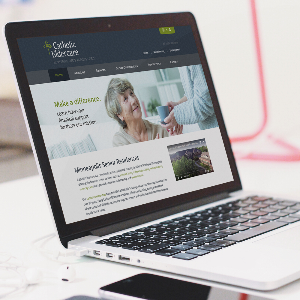 Catholic Eldercare website displayed on a laptop