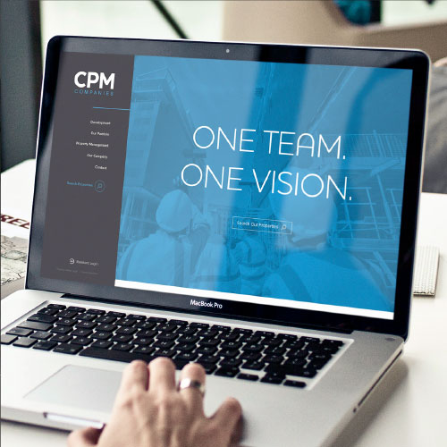 Laptop with CPM website displayed on the screen