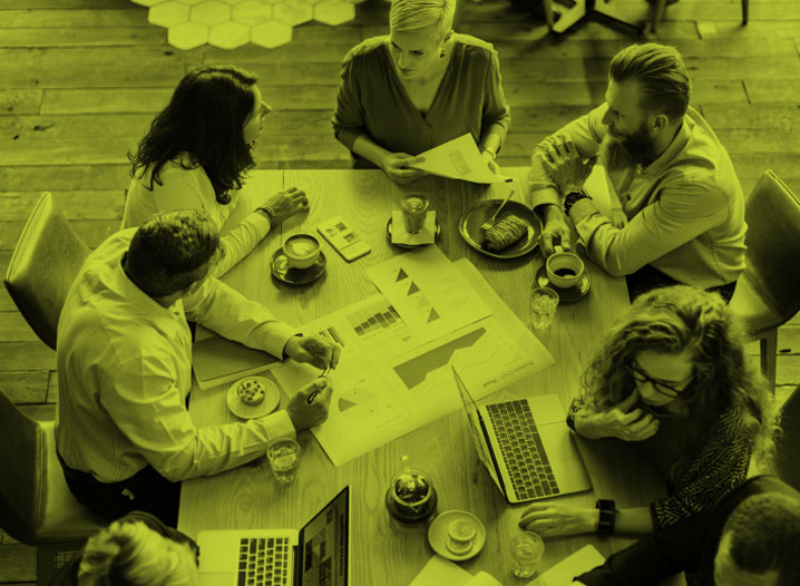 Group around a table in a marketing meeting