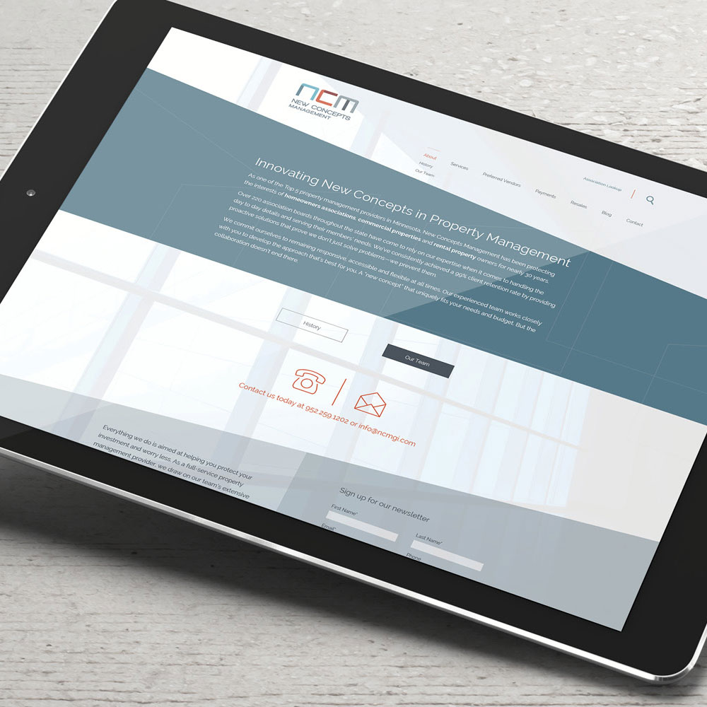 New Concepts Management website displayed on a tablet